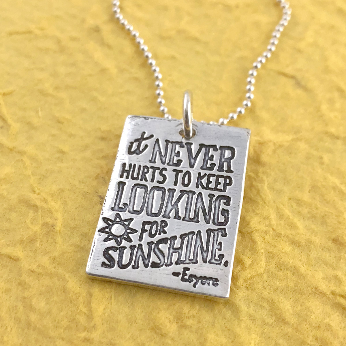 It Never Hurts to Keep Looking for Sunshine - Eeyore Inspirational Quote Necklace