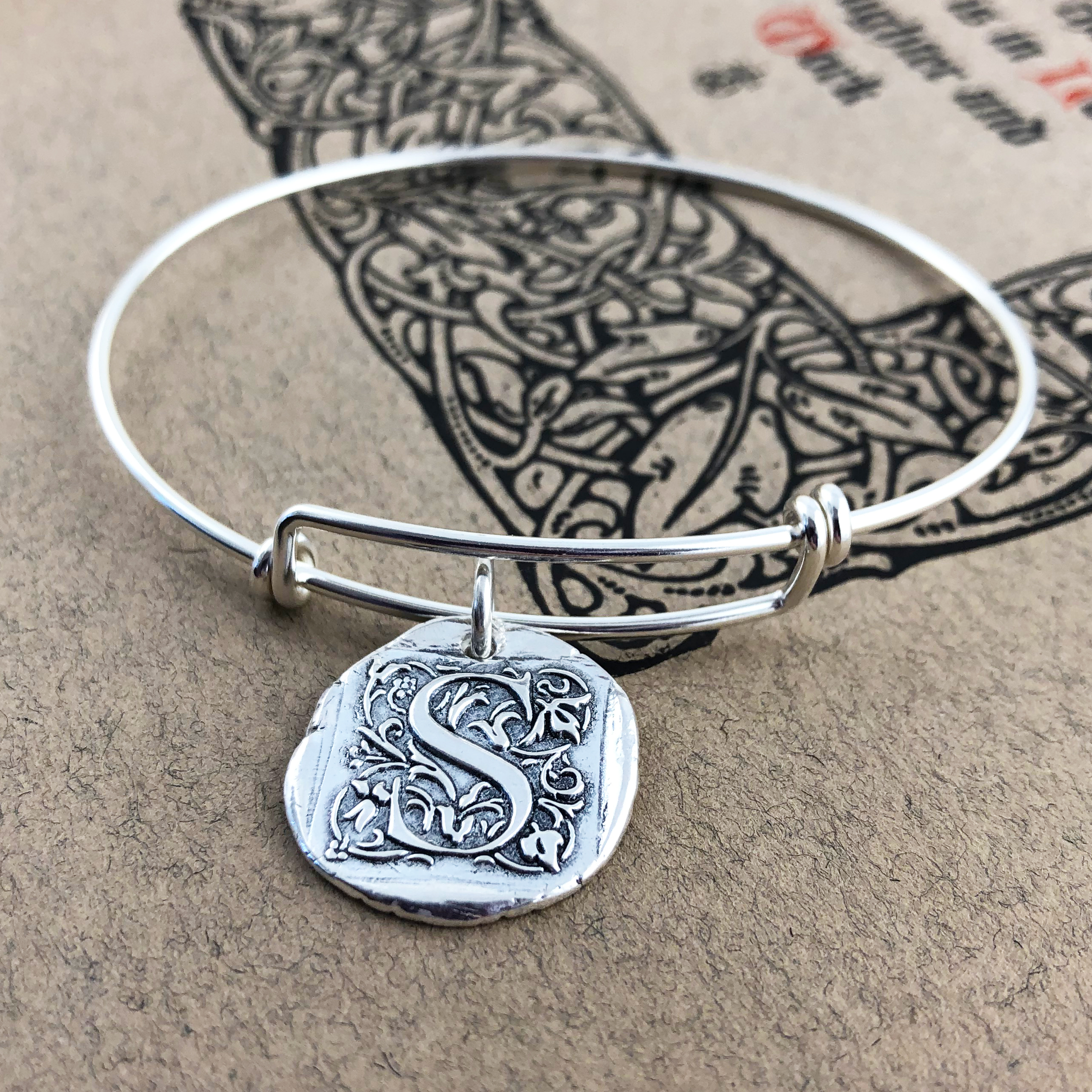 Initial Cap Wax Seal Charm shown on bangle