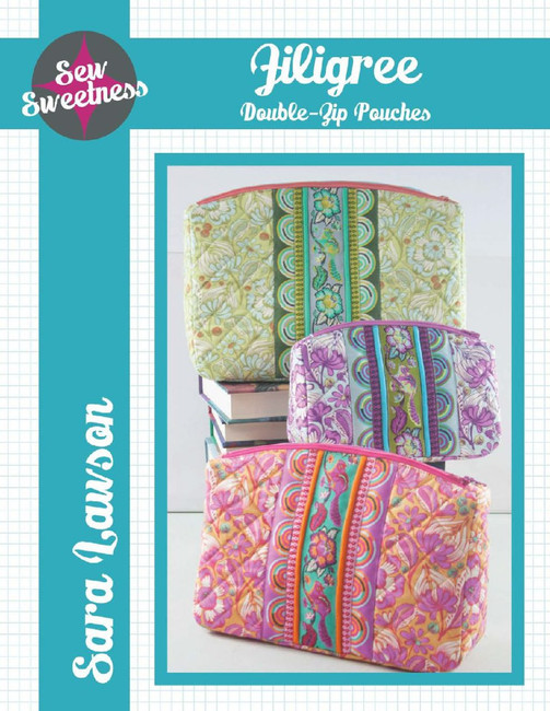 These lovely zipper pouches come in 3 different size options. Each includes instructions for attaching the optional ribbon detailing and machine quilting on the front. The most special thing about these zipper pouches is that there are two top zippers, with two separate compartments for storage. The side panel on the pouch ensures that it will stand up by itself, making this the perfect companion for craft or personal storage.