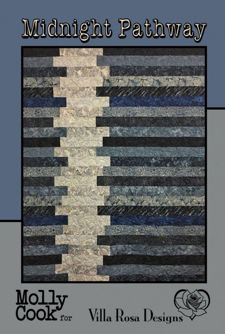 """Midnight Pathway 52"""" x 72""""  We cut the strips with an Accuquilt cutter. We used the 2 1/2 strips in our quilt instead of the 3 1/2 strips in the pattern because we like the variety. You have enough strips to make the same size quilt.   Kit Contains:  39-2 1/2"""" strips of Indigo Clue (Will only need 36 strips) 12 2 1/2"""" strips of Contrast Fabric 5/8 yd of fabric for binding Midnight pathway pattern"""