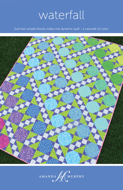 "Just two simple blocks make one dynamic quilt - a cascade of color  54 1/2"" x 72 1/2"""