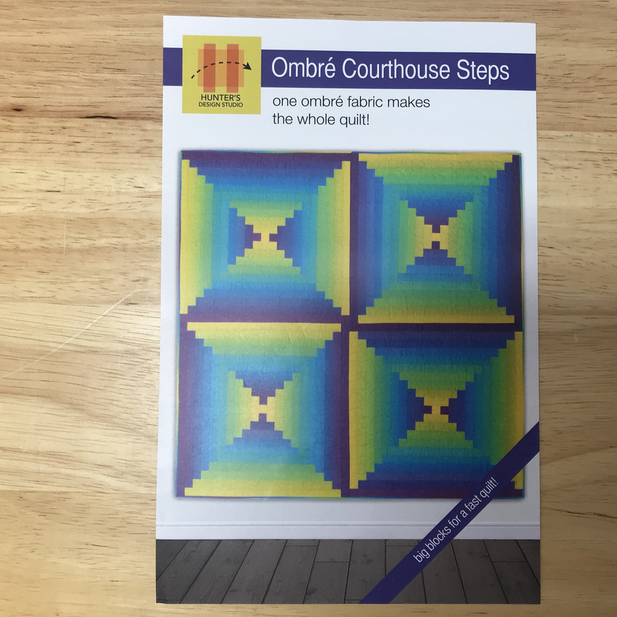 The color and value gradations in ombré fabrics make sophisticated color and shading transitions possible in classic blocks like the Courthouse Steps. In this quilt, the ombré shading makes the Courthouse Steps glow. The blocks are large scale for dramatic impact (and a faster sew!) finishing at 31 1/2'' square.
