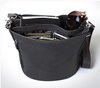 Multiple pockets give utility to concealed carry handbag