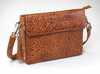 Embossed leaf pattern makes for high style in this concealed carry handbag