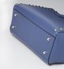 Metal studs protect your stylish bag