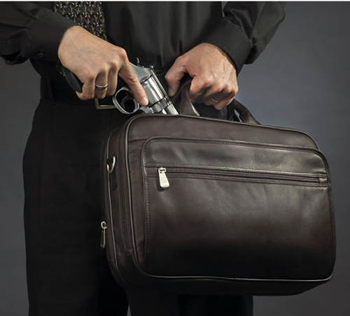 Immediate and easy access to concealed carry weapon from this working handbag