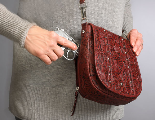Beautiful hand tooling can take your concealed carry into everyday or dressy environments