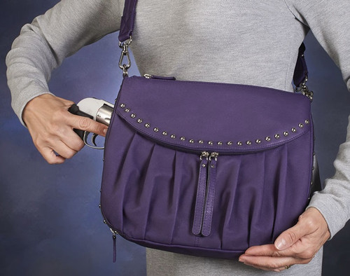 Protection has never come in so beautiful a package as the Uptown Concealed Carry Tote