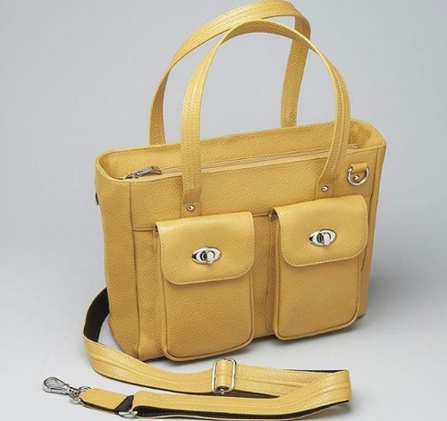 Crossbody and short handle carry makes your choice of carry easy