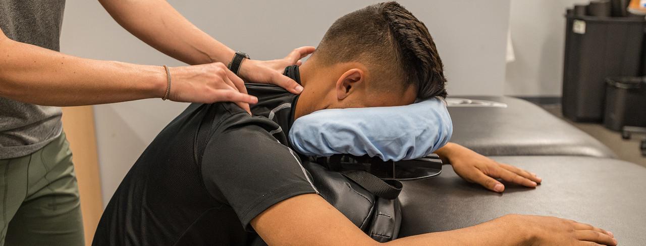 With the patient seated, the Face Crescent, Chest Support, and Pelvic Support are folded and placed on the lap, the chest rests against the Chest Support.