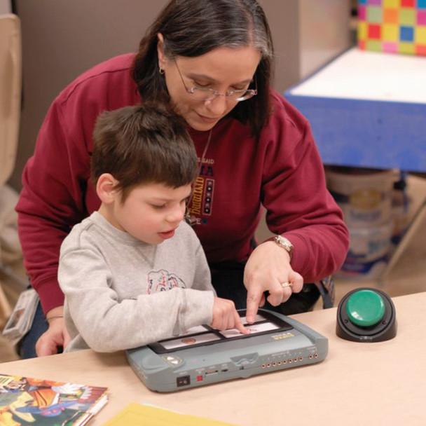 Child and adult using the SuperTalker Progressive Communicator.