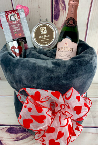 Luxurious throw with Gruet Champagne, bath beads, chocolate and a candle.  A perfect combination for a pampering night.