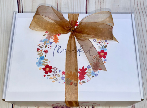 A gorgeous personalized box all wrapped up for the perfect presentation.