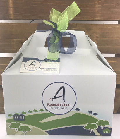 Custom printed gable box filled with welcome home goodies.