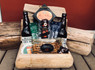 A beautiful driftwood box filled with their favorite beer, beer nuts, beer cheese, summer sausage, CB Nuts, Seattle Sinsation Pretzels, #beerking glass, beer magnet and Godiva Chocolates.