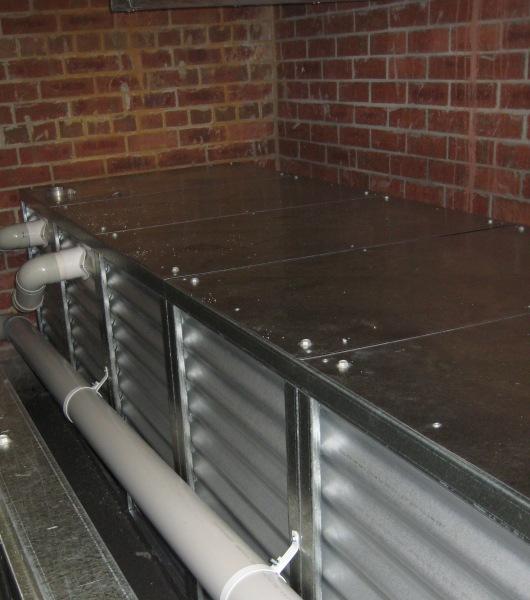 Steel slimline modular low height tanks in under floor area