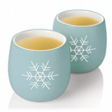 Enjoy tea for two with these pleasing to look at, delightful to drink from AMIE tea cups. Beautifully glazed and uniquely shaped, these cups complement the experience of sharing your favorite tea.  Durable ceramic 6oz capacity per cup