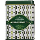 White Christmas Tea is a hand-picked white tea blended with almonds, vanilla and cardamom, accented by white chamomile flowers in a beautiful decorative tin.