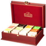 Basilur Tea – Premium Tea in Handmade Wooden Tea Chest An assortment of premium quality gourmet tea This handcrafted wooden box contains 12 varieties of premium quality gourmet tea from Basilur. A luxurious, exotic collection of specialty Teas for that perfect gift that will surely be cherished!  Product Details: 12 varieties of individually wrapped foil enveloped tea bags  (Contains tea bags with pure black tea, pure green tea, and black and green tea with fruits and flowers and flavours)