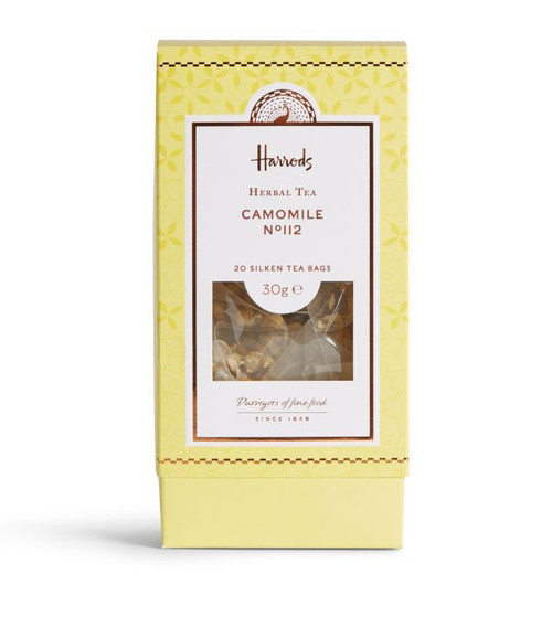 Unwind from the day with this relaxing aroma of sweet honey and florals. Warm your evenings with this fine Harrods Camomile Nº112 Tea. Releasing from silken triangular bags, this soothing flower emits sweet honey notes and encourages a restful sleep. Best served black, let your cup steep to enhance the aromas and flavour.   NUTRITIONAL INFORMATION - PER 100G   NEED TO KNOW Vegan Herbal tea 30g INGREDIENTS - ALLERGENS IN BOLD For allergens, see ingredients listed in bold: 100% camomile flowers