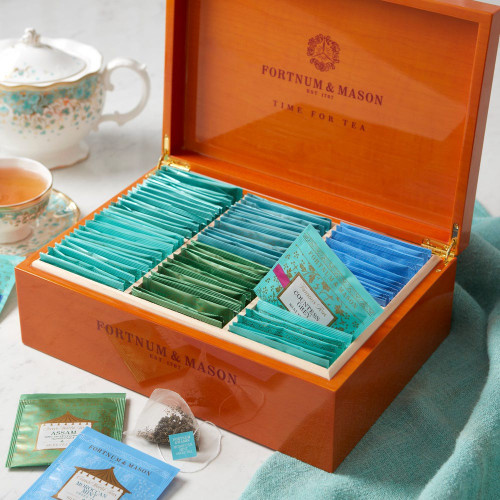 Lift the lid on this wooden restaurant box filled with 90 silky pyramid teabags of our Famous and Classic World blends. Choose from Royal Blend, Countess Grey, Darjeeling FTGOP, Assam TGFOP and Moroccan Mint, selected to deliver the perfect cup for every time of day. Once the box is empty, simply refill and start all over again.