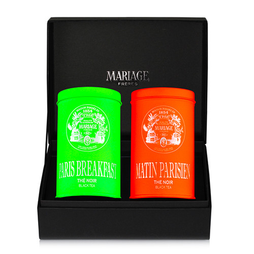 Two canisters of tea in a black presentation case - two ways of discovering new realms of taste, colour and joint pleasures.   PARIS BREAKFAST TEA, green tin : black tea   MATIN PARISIEN, orange tin : black tea   Black classical presentation case holding 2 colorful canisters, each containing 100g of flavoured tea.