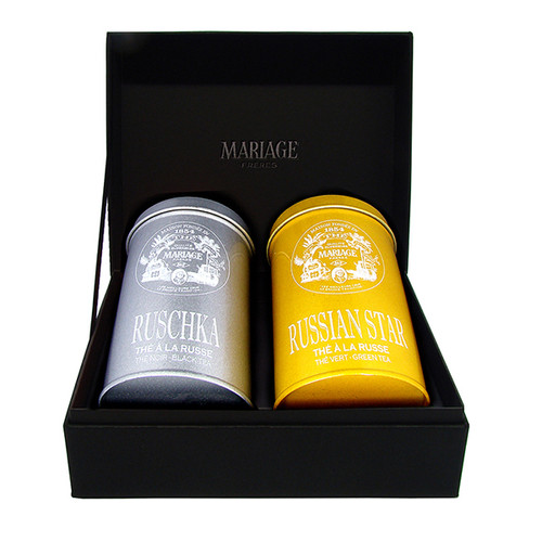 Two canisters of tea in a black presentation case - two ways of discovering new realms of taste, colour and joint pleasures.   RUSCHKA, silver tin : black tea with bergamot and citrus   RUSSIAN STAR golden tin : green tea with fruits and bergamot   Black classical presentation case holding 2 colorful canisters, each containing 100g of flavoured tea.