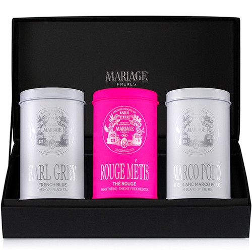 Mariage Frères has created a new black gift case containing three lacquered canisters.  They hold three blended teas that one can prepare at any moment of the day.   - EARL GREY FRENCH BLUE : black tea  - ROUGE MÉTIS : naturally theine-free red tea  - MARCO POLO BLANC : white tea   Black classical presentation case holding 100g of black scented tea & rooibos scented tea and 30g of white scented tea in colourful canisters.