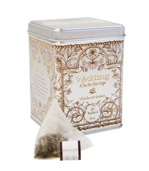 Wedding Tea as an elegant blend for your momentous event. It features Mutan White tea with lemon-vanilla to taste, and a touch of pink rosebuds and petals. The lovely silver tin with vintage style design features 20 tea sachets, perfect as a bridal shower gift or favor. Each sachet brews a 12 oz. cup of tea. Caffeinated.