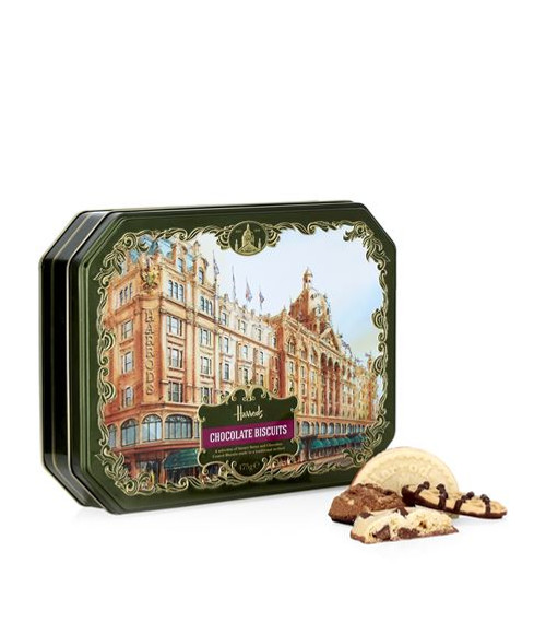 DETAILS Made in the United Kingdom May contain sesame seed traces Food & Wine: Biscuits & Cakes Harrods Heritage Chocolate Biscuit Tin (475g) Food & Wine: Biscuits & Cakes Harrods Heritage Chocolate Biscuit Tin (475g) OVERVIEW This delightful green and gold tin features a scrumptious array of mouth-watering biscuits, which have been made to a traditional method for Harrods. The selection includes sweet and chocolate coated biscuits, delicately wrapped within a printed tin showcasing our Terracotta palace. Perfect as a souvenir or for gifting, they will complement any afternoon tea effortlessly.  INGREDIENTS  Wheat flour -with calcium, iron, niacin, thiamin-, milk chocolate (16%) -sugar, cocoa butter, whole milk powder, cocoa mass, emulsifier: soya lecithin; natural vanilla flavouring-, salted butter(16%) (milk), dark chocolate (12%) -sugar, cocoa mass, cocoa butter, emulsifier: soya lecithin; natural vanilla flavouring-, sugar, rolled oats, invert sugar syrup -sugar syrup, cane molasses-, dark chocolate chunks (2%) -sugar, cocoa mass, cocoa butter, emulsifier: soya lecithin; natural vanilla flavouring-, brown sugar -sugar, cane molasses-, pecan nuts, honey, desiccated coconut -coconut, sulphur dioxide-, pasteurised eggs, dark chocolate chips -sugar, cocoa mass, cocoa butter, emulsifier: soya lecithin; natural vanilla flavouring-, raw cane sugar, nibbed almonds, macadamia nuts, nibbed hazelnuts, stem ginger -ginger, sugar-, sultanas -sultanas, cotton seed oil-, raising agents: -sodium bicarbonate, diphosphate, wheat flour-, lemon zest, malt extract (barley), soya flour, cocoa powder, ground ginger, skimmed milk powder, egg powder, rice flour, natural flavouring, flavouring, colour: annatto. milk chocolate contains cocoa solids 34% minimum and milk solids 20% minimum. dark chocolate contains cocoa solids 51% minimum. dark chocolate chunks & chips contain cocoa solids 39% minimum