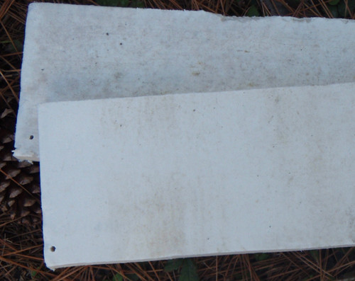 Compressed ceramic fiber insulative board used for heat risers in later models instead of vermiculite board. This material is not structural, but significantly more robust than vermiculite board.