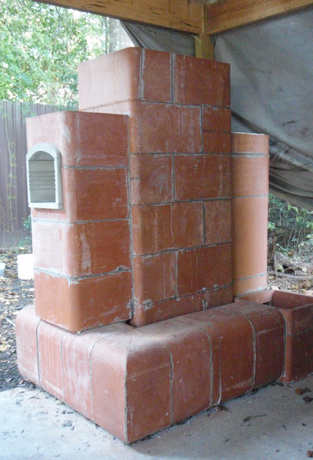 """8"""" Dragon Masonry Heater with Heated Bench as the 2nd bell. This is the demonstration system we built outside. The oven is in the second bell and it needs to be in the heat riser stack instead."""