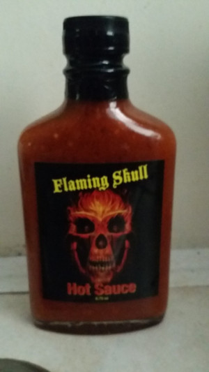 Flaming Skull Hot Sauce Great taste and all the heat . Ingredients: Chocolate Reaper, Chocolate Dougla, Chocolate Moruga, 7 Pot Primo, Jolokia (Ghost), Orange Habanero, water, Distilled vinegar, xanthan gum, Onion Powder, Garlic Powder, Sodium Benzoate.