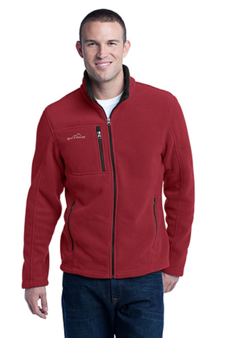 This super soft and warm jacket is as comfortable as it gets for fall hikes and everyday excursions. Contrast rolled top collar, zippered chest pocket, reverse coil contrast zippers, front zippered pockets with tricot lining, open cuffs and an open hem. Contrast Eddie Bauer logo embroidered on right chest. Made of 12-ounce, 100% polyester fleece which incorporates Low Impact Technology™ for enhanced softness and performance.  REDRHUBARB