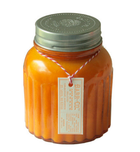 Large apothecary-style jar candle in orange amber scent.