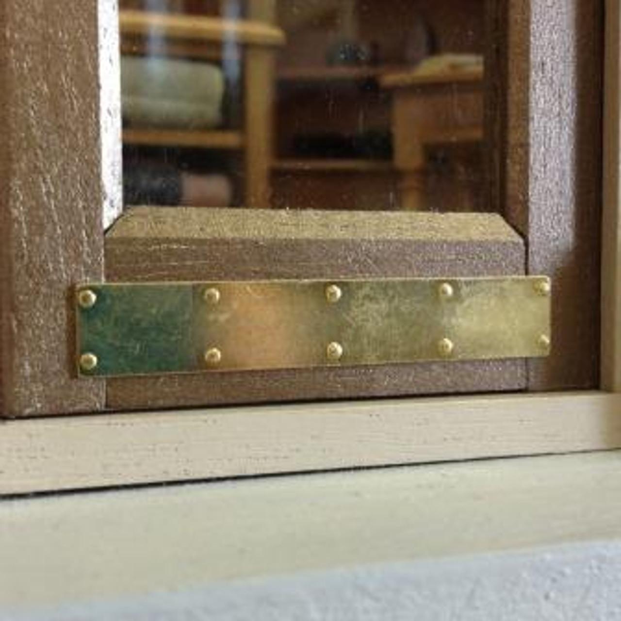 Brass kick plate shown installed on a miniature door.
