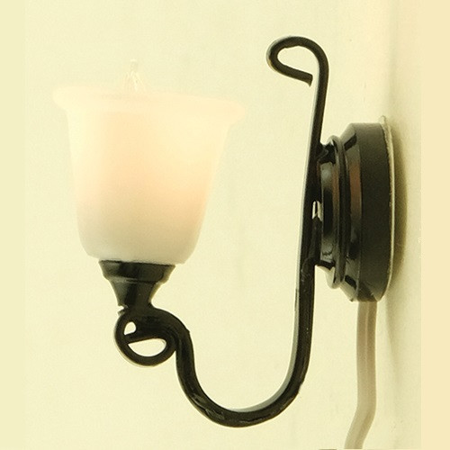Dollhouse Miniature Black Wall Sconce (MH45133) shown lit against light background
