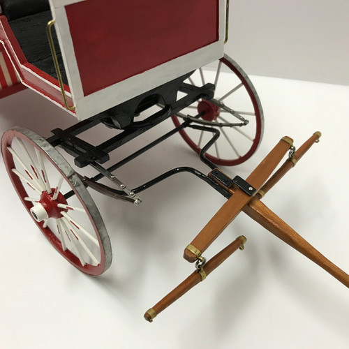 One-inch (1:12) scale dollhouse miniature ice cream wagon (circa 1895) undercarriage