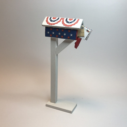 Bunting and stars patriotic mailbox shown open