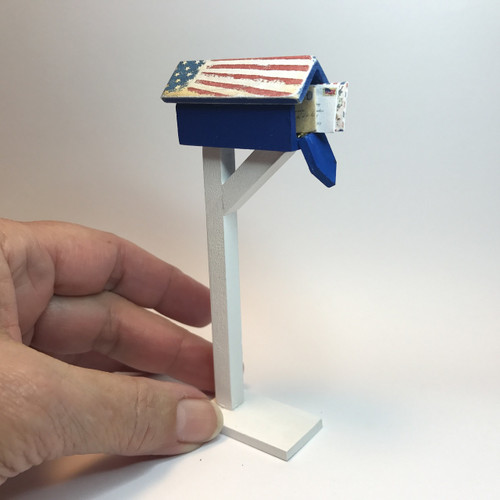 Patriotic mailbox with distressed flag roof, show open