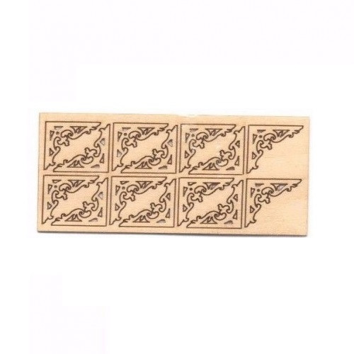 Miniature fretwork pieces shown in frame as shipping