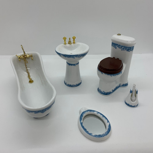 White dollhouse bathroom with blue floral pattern trim; viewed from top