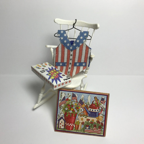 Patriotic Vest (JJR08-1002) shown hanging from a chair with a box of fireworks and a patriotic wall hanging (not included)