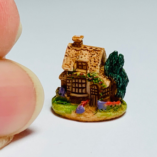 Tiny Cottage Sculpture (FCA4326) with fingers for scale