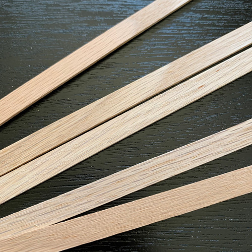 """1/16"""" x 3/8"""" x 24"""" (BNM9226SO); image shows wood grain variations of several strips"""