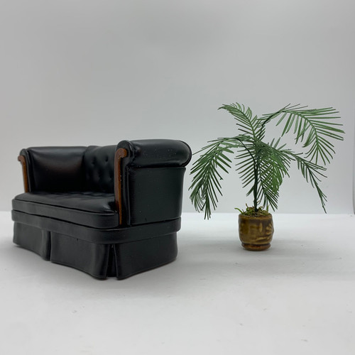 Small Palm Plant (UFN3008) shown with black leather sofa