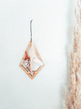 dried flower and wood ornament
