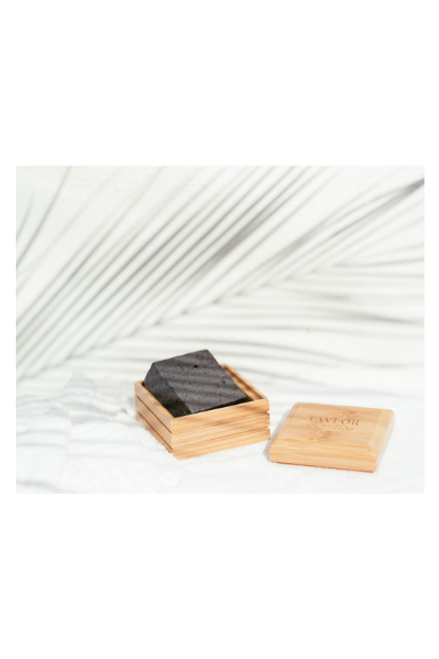 bamboo soap box with black african soap inside, shaped in a square