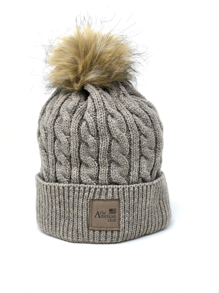WOMEN'S KNIT HAT. THE AMERICAN CLUB LOGO EXCLUSIVELY. 2 COLOR OPTIONS.