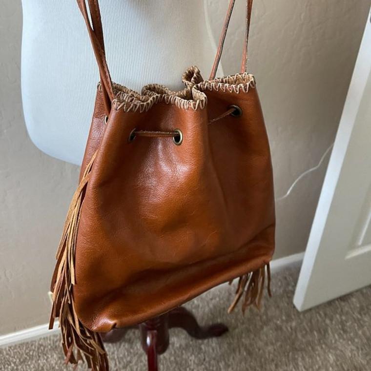 Patricia Nash saddle leather bucket bag with fringe, 12 x 1